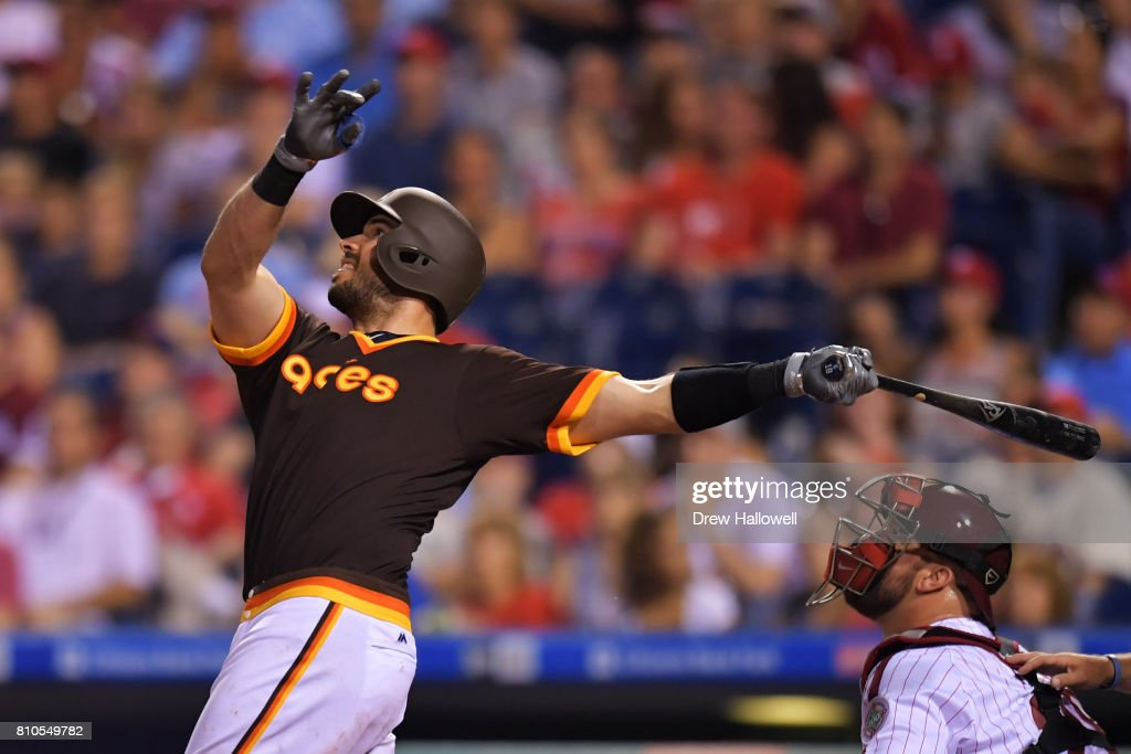 Austin Hedges #18 of the San Diego Padres hits the game winning sacrifice fly ball in the ninth inning against the Philadelphia Phillies at Citizens Bank Park on July 7, 2017 in Philadelphia, Pennsylvania.