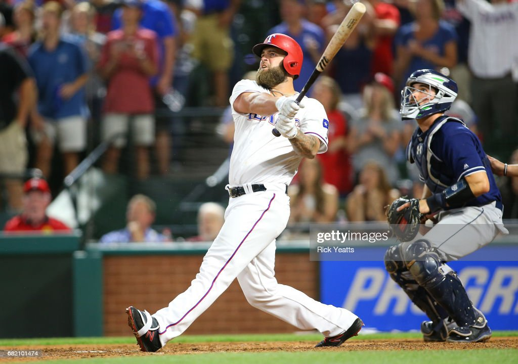 Austin Hedges #18 of the San Diego Padres looks on as Mike Napoli #5 of the Texas Rangers hits a three-run, walk-off home run in the ninth inning at Globe Life Park in Arlington on May 11, 2017 in Arlington, Texas.