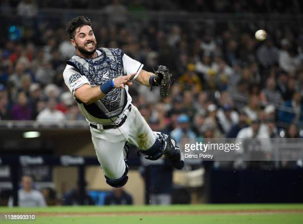 Austin Hedges of the San Diego Padres makes a throw to first base to get the out on Mallex Smith of the Seattle Mariners during the third inning of a...