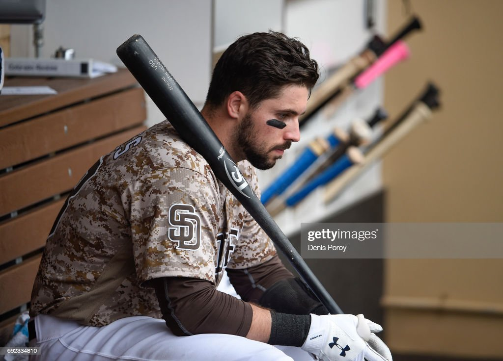 Austin Hedges #18 of the San Diego Padres sits in the dugout during the seventh inning of a baseball game against the Colorado Rockies at PETCO Park on June 4, 2017 in San Diego, California.