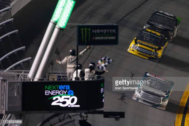 Austin Hill driver of the Hattori Racing Enterprises CHIBA Toyopet Toyota takes the checkered flag in front of Grant Enfinger driver of the ThorSport...
