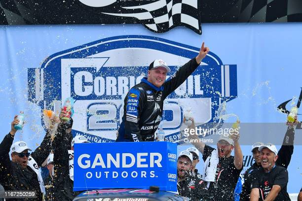Austin Hill driver of the Hino/AISIN Group Toyota celebrates in Victory Lane after winning the NASCAR Gander Outdoor Truck Series Corrigan Oil 200 at...