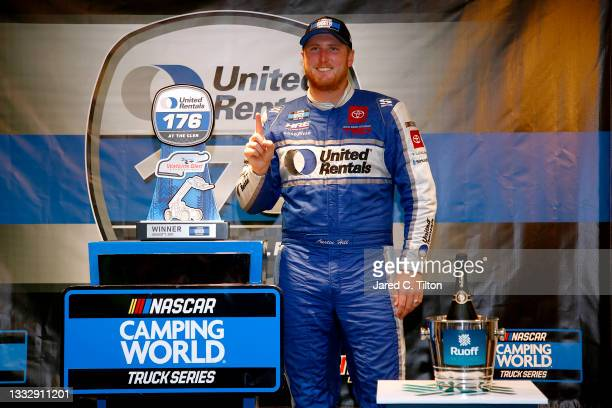 Austin Hill, driver of the United Rentals Toyota, celebrates in victory lane after winning the NASCAR Camping World Truck Series United Rentals 176...