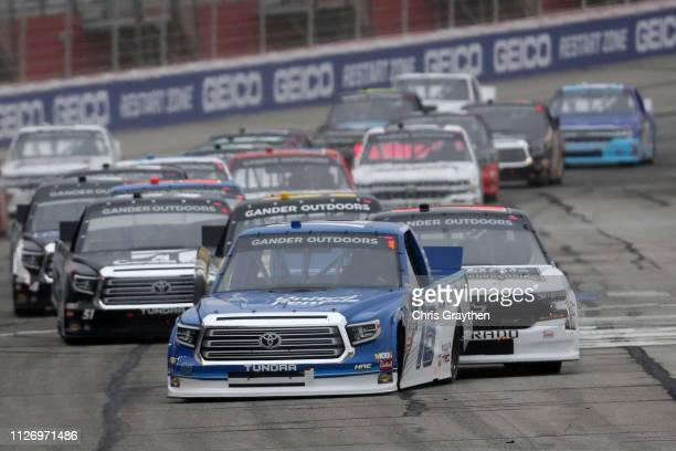 Austin Hill driver of the United Rentals Toyota leads during the NASCAR Gander Outdoors Truck Series Ultimate Tailgating 200 at Atlanta Motor...