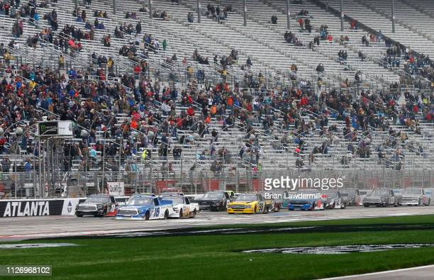 Austin Hill driver of the United Rentals Toyota leads the field to the green flag during the NASCAR Gander Outdoors Truck Series Ultimate Tailgating...