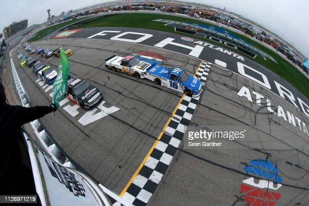 Austin Hill driver of the United Rentals Toyota leads the field to the green flag to start the NASCAR Gander Outdoors Truck Series Ultimate...