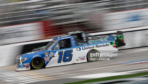 Austin Hill driver of the United Rentals Toyota races during the NASCAR Gander Outdoors Truck Series Ultimate Tailgating 200 at Atlanta Motor...