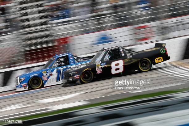 Austin Hill driver of the United Rentals Toyota races Joe Nemechek driver of the Chevrolet during the NASCAR Gander Outdoors Truck Series Ultimate...