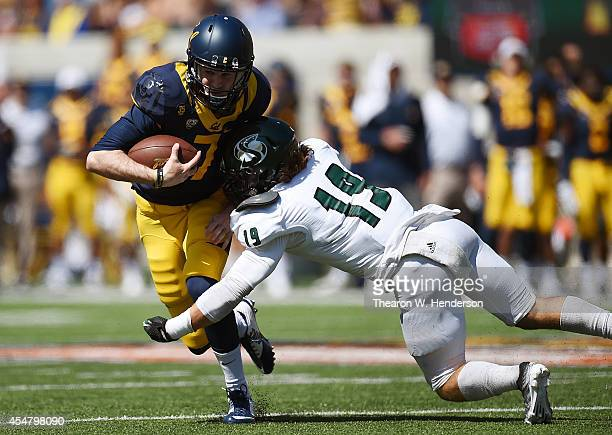 Austin Hinder of the California Golden Bears gets tackled by Nick Crouch of the Sacramento State Hornets during the third quarter of an NCAA Football...