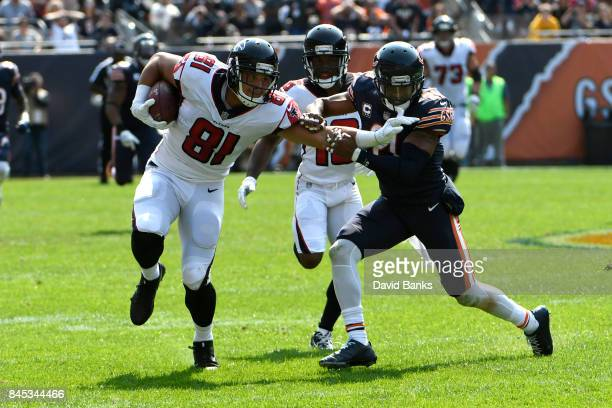 Austin Hooper of the Atlanta Falcons carries the football toward the endzone against Quintin Demps of the Chicago Bears in the fourth quarter at...