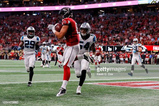 Austin Hooper of the Atlanta Falcons catches a pass for a touchdown during the first half against the Carolina Panthers at Mercedes-Benz Stadium on...