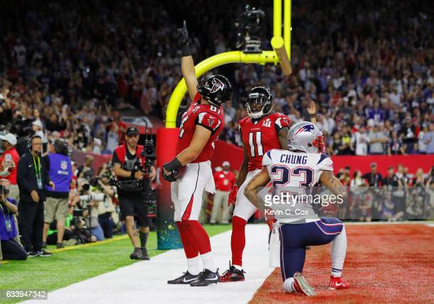 Austin Hooper of the Atlanta Falcons celebrates after scoring a 19 yard touchdown in the second quarter against Patrick Chung of the New England...