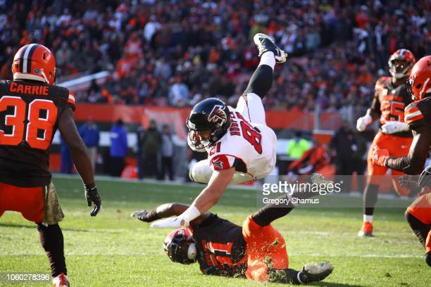 Austin Hooper of the Atlanta Falcons flies through the air after being tackled by Jamie Collins of the Cleveland Browns at FirstEnergy Stadium on...