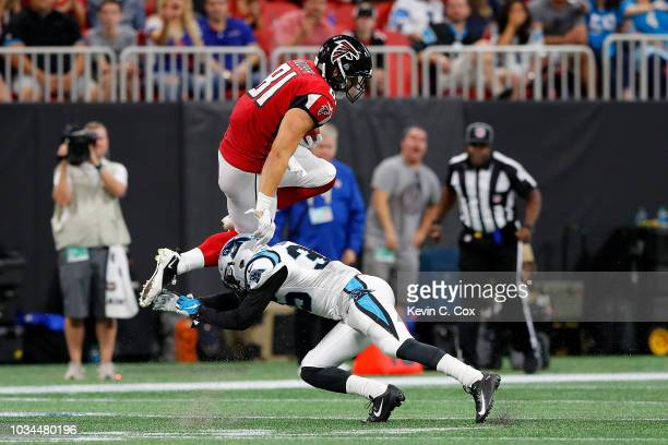 Austin Hooper of the Atlanta Falcons is tackled by Corn Elder of the Carolina Panthers during the second half at Mercedes-Benz Stadium on September...