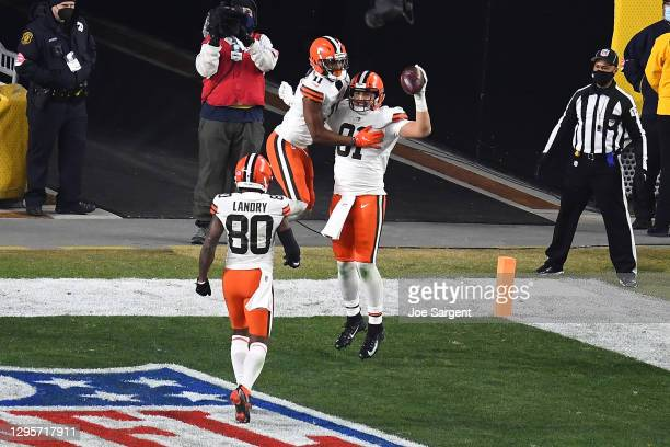 Austin Hooper of the Cleveland Browns celebrates a touchdown with Donovan Peoples-Jones during the first half of the AFC Wild Card Playoff game...
