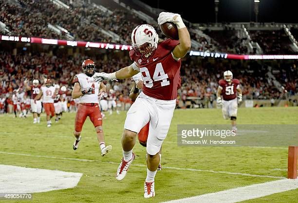 Austin Hooper of the Stanford Cardinal scores a touchdown pass in the 1st overtime against the Utah Utes at Stanford Stadium on November 15 2014 in...
