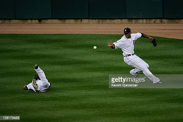 Austin Jackson fields the ball as Ryan Raburn of the Detroit Tigers fails to make a catch on a hit by David Murphy of the Texas Rangers in the sixth...