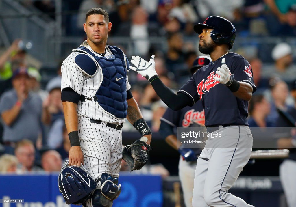 Austin Jackson #26 of the Cleveland Indians celebrates his eighth inning home run as Gary Sanchez #24 of the New York Yankees looks on at Yankee Stadium on August 28, 2017 in the Bronx borough of New York City.