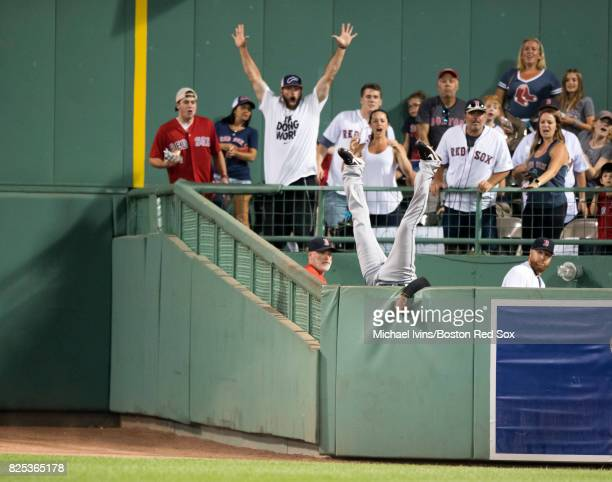 Austin Jackson of the Cleveland Indians flips over the bullpen wall after robbing Hanley Ramirez of the Boston Red Sox of a home run in the fifth...