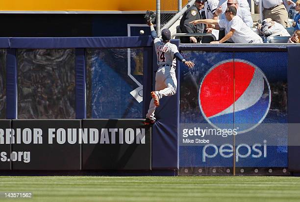 Austin Jackson of the Detroit Tigers attempts to catch Curtis Granderson of the New York Yankees fourth inning home run at Yankee Stadium on April 29...
