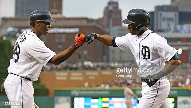Austin Jackson of the Detroit Tigers celebrates with teammate Torii Hunter after hitting a solo home run in the fifth inning during the game against...