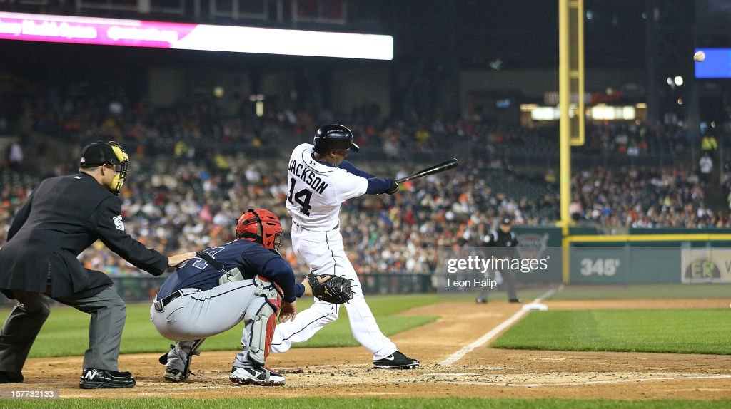 Austin Jackson #14 of the Detroit Tigers hits a three-run home run in the third inning scoring Brayan Rena #55 and Omar Infante #4 during the game against the Atlanta Braves at Comerica Park on April 28, 2013 in Detroit, Michigan.