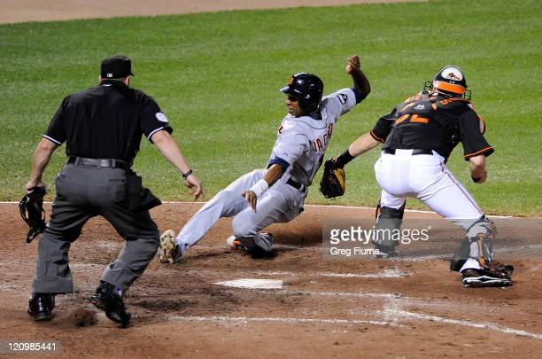 Austin Jackson of the Detroit Tigers is tagged out at home plate in the fourth inning by Matt Wieters of the Baltimore Orioles at Oriole Park at...