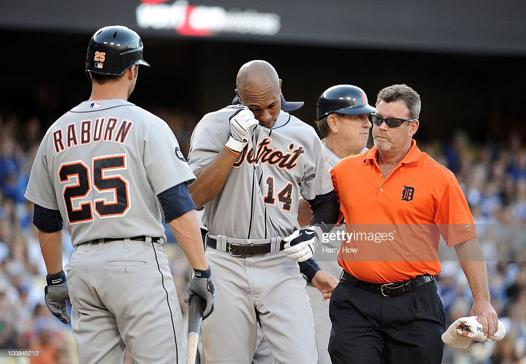 Austin Jackson #14 of the Detroit Tigers leaves the field after he was hit by a pitch from Ramon Troncoso #38 of the Los Angeles Dodgers during the eighth inning at Dodger Stadium on May 22, 2010 in Los Angeles, California.