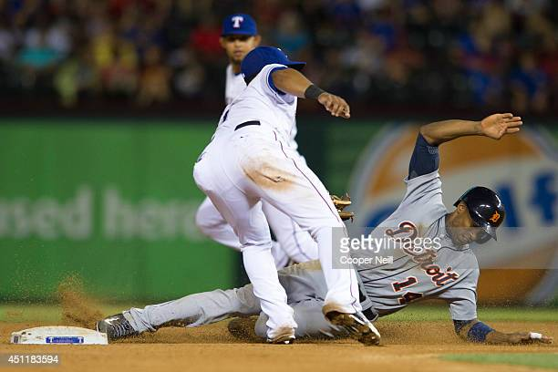 Austin Jackson of the Detroit Tigers safely steals second base during the seventh inning against the Texas Rangers on June 24 2014 at Globe Life Park...