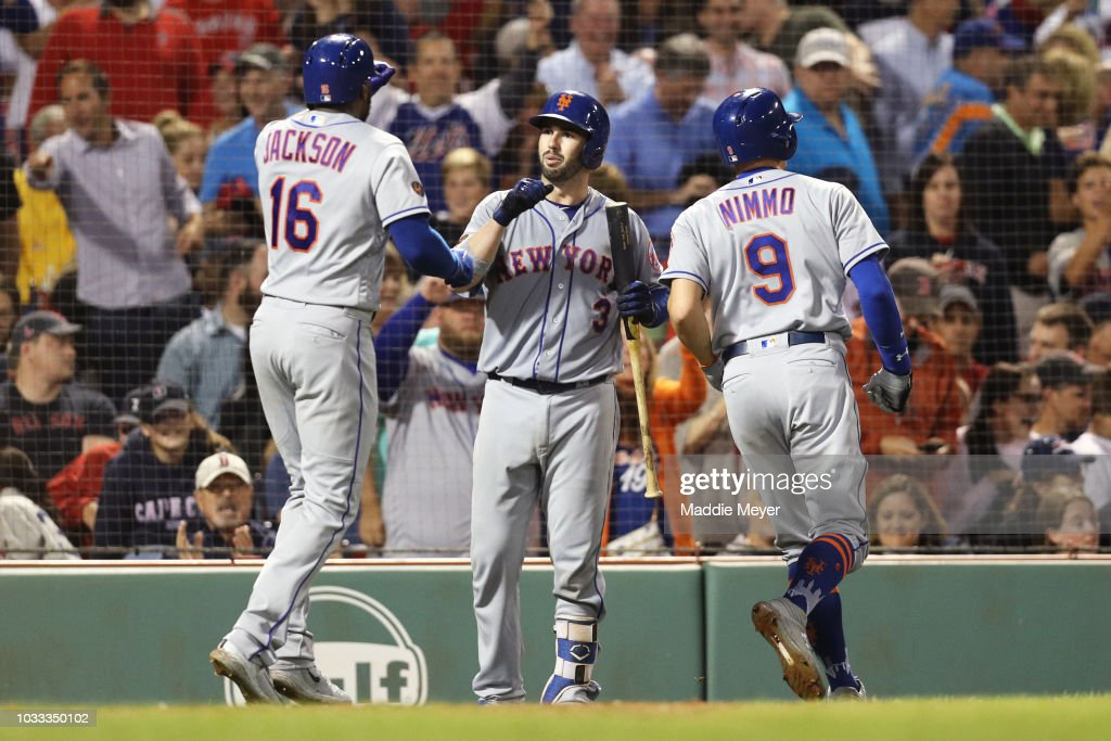 Austin Jackson #16 of the New York Mets and Brandon Nimmo #9 celebrate with Tomas Nido #3 after Jackson hit a two run home run against the Boston Red Sox during the eighth inning at Fenway Park on September 14, 2018 in Boston, Massachusetts.