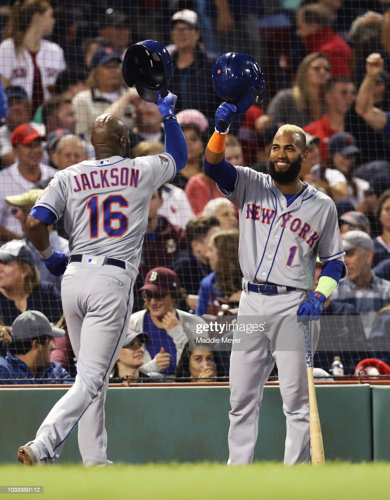 Austin Jackson #16 of the New York Mets celebrates with Amed Rosario #1 after hitting a two run home run against the Boston Red Sox during the eighth inning at Fenway Park on September 14, 2018 in Boston, Massachusetts.