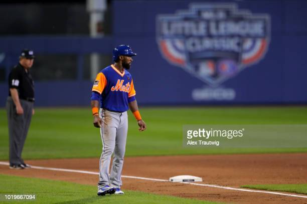 Austin Jackson of the New York Mets leads off third base during the 2018 Little League Classic against the Philadelphia Phillies at Historic Bowman...