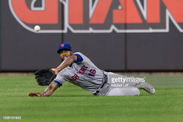Austin Jackson of the New York Mets makes a diving catch on a ball hit by Odubel Herrera of the Philadelphia Phillies in the bottom of the third...