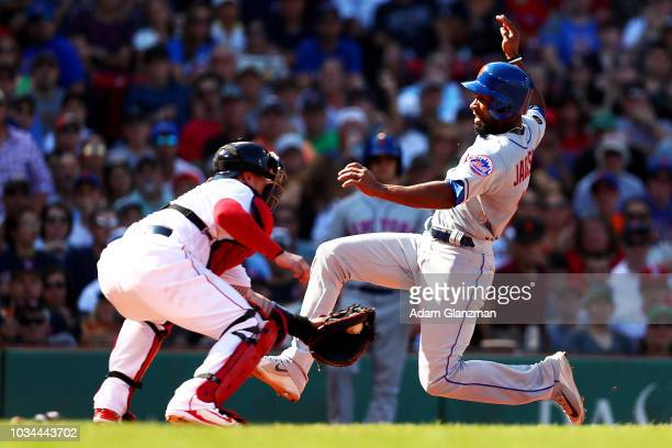 Austin Jackson of the New York Mets scores against Christian Vazquez of the Boston Red Sox in the sixth inning of a game at Fenway Park on September...