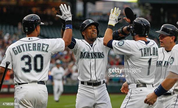 Austin Jackson of the Seattle Mariners is congratulated by teammates after hitting a grand slam in the third inning against the Detroit Tigers at...
