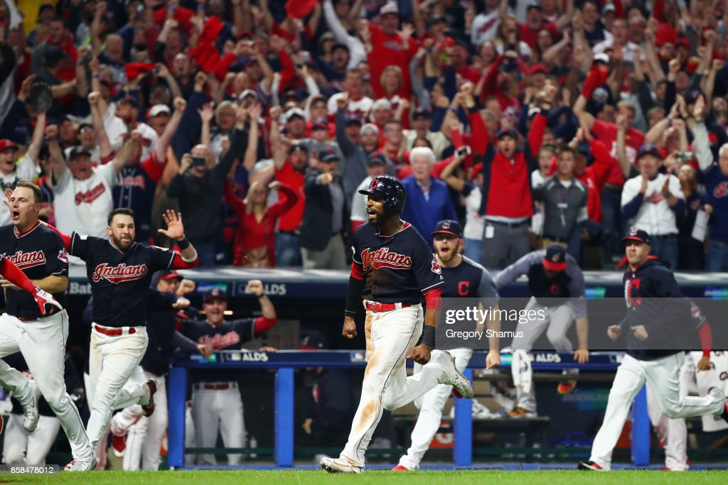 Austin Jackson #26 runs home to score the winning run on a single by Yan Gomes #7 of the Cleveland Indians to win the game 9 to 8 in the 13th inning during game two of the American League Division Series at Progressive Field on October 6, 2017 in Cleveland, Ohio.