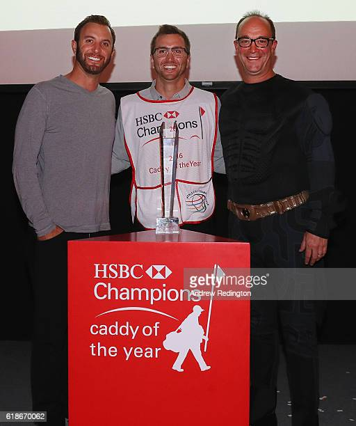 Austin Johnson is presented with his Caddy of the Year Award by HSBC's Giles Morgan and player/brother Dustin Johnson after the first round of the...
