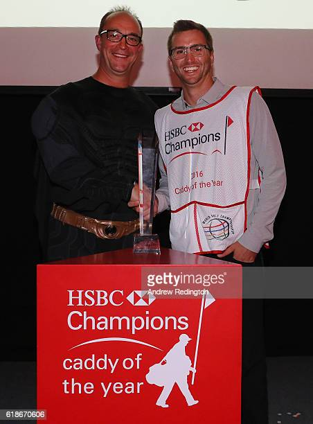 Austin Johnson is presented with his Caddy of the Year Award by HSBC's Giles Morgan after the first round of the WGC HSBC Champions at the Sheshan...