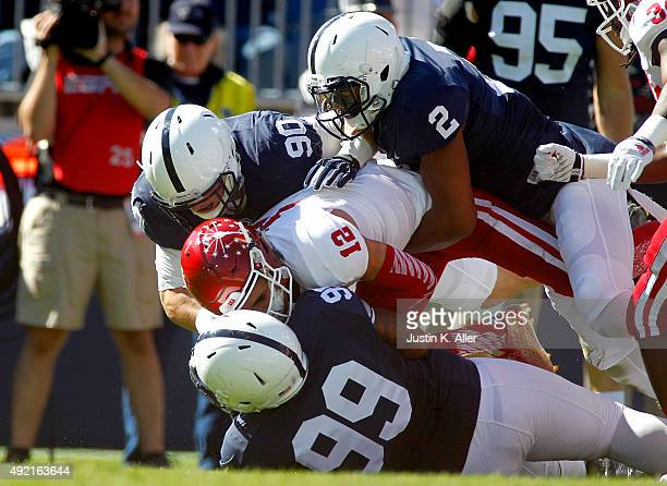 Austin Johnson, Marcus Allen and Garrett Sickels of the Penn State Nittany Lions sack Zander Diamont of the Indiana Hoosiers in the first half during...