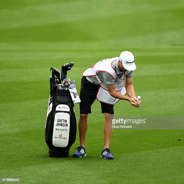 Austin Johnson the 'HSBC Caddie of the Year' and brother of Dustin Johnson of the United States attemps to catch his players ball during the third...