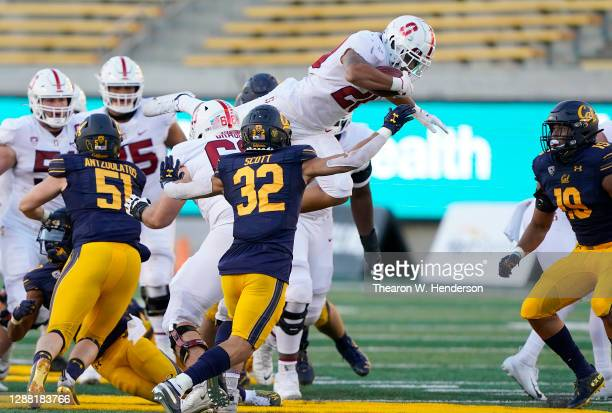 Austin Jones of the Stanford Cardinal leaps in the air before getting tackled against the California Golden Bears during the fourth quarter of their...