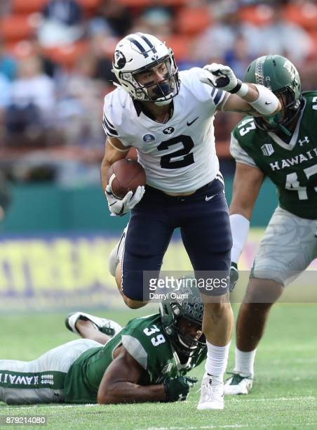Austin Kafentzis of the BYU Cougars breaks a tackle during the first quarter of the game against the Hawaii Rainbow Warriors at Aloha Stadium on...