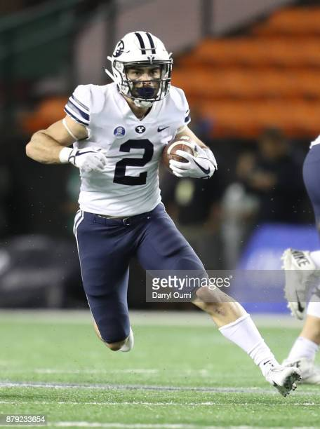 Austin Kafentzis of the BYU Cougars runs the ball during the second half of the game against the Hawaii Rainbow Warriors at Aloha Stadium on November...