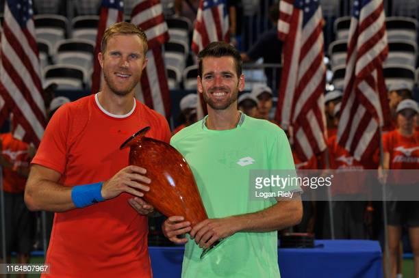 Austin Krajicek and Dominic Inglot of United Kingdom hold the championship doubles trophy after defeating Bob Bryan and Mike Bryan during the BB&T...