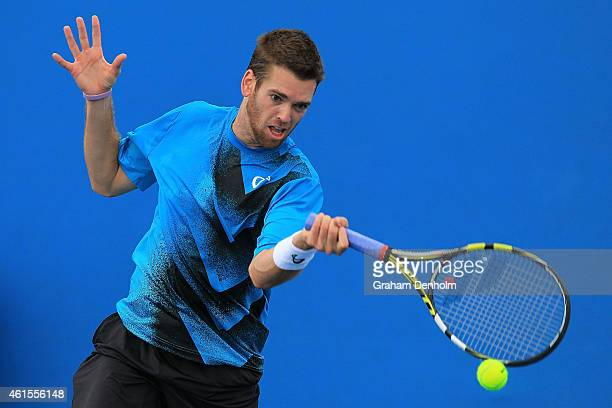 Austin Krajicek of the United States plays a forehand in his qualifying match against Kyle Edmund of Great Britain for the 2015 Australian Open at...