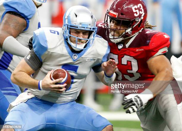 Austin Larkin of San Antonio Commanders takes down Josh Woodrum of the Salt Lake Stallions during the fourth quarter of the Alliance of American...