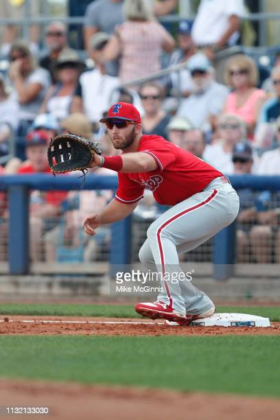 Austin Listi of the Philadelphia Phillies makes the grab at first base for an out during the Spring Training game against the Tampa Bay Rays at...