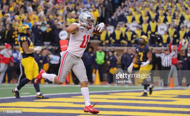 Austin Mack of the Ohio State Buckeyes celebrates a fourth quarter touchdown during the game against the Michigan Wolverines at Michigan Stadium on...