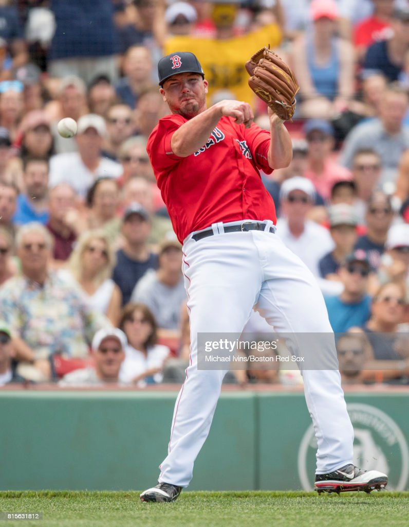 Austin Maddox #71 of the Boston Red Sox attempts an off balance throw to first base against the New York Yankees in the sixth inning during game one of a doubleheader at Fenway Park on July 16, 2017 in Boston, Massachusetts.