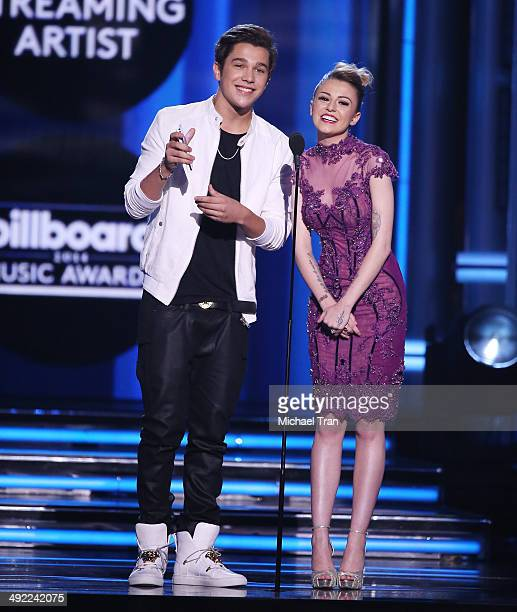 Austin Mahone and Cher Lloyd speak onstage during the 2014 Billboard Music Awards held at MGM Grand Garden Arena on May 18 2014 in Las Vegas Nevada